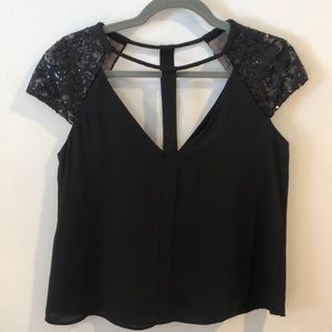 BCBG MaxAzria Sierra black top with cutouts. NWT